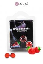 2 Brazilian Balls - fraise : La chaleur du corps transforme la brazilian ball en liquide glissant au parfum fraise, votre imagination s'en trouve exacerbée.